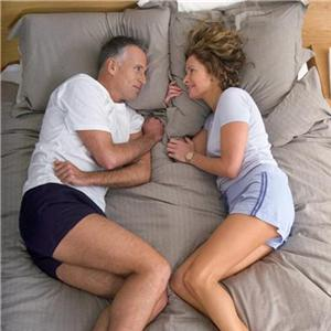 Couple in bed low back pain