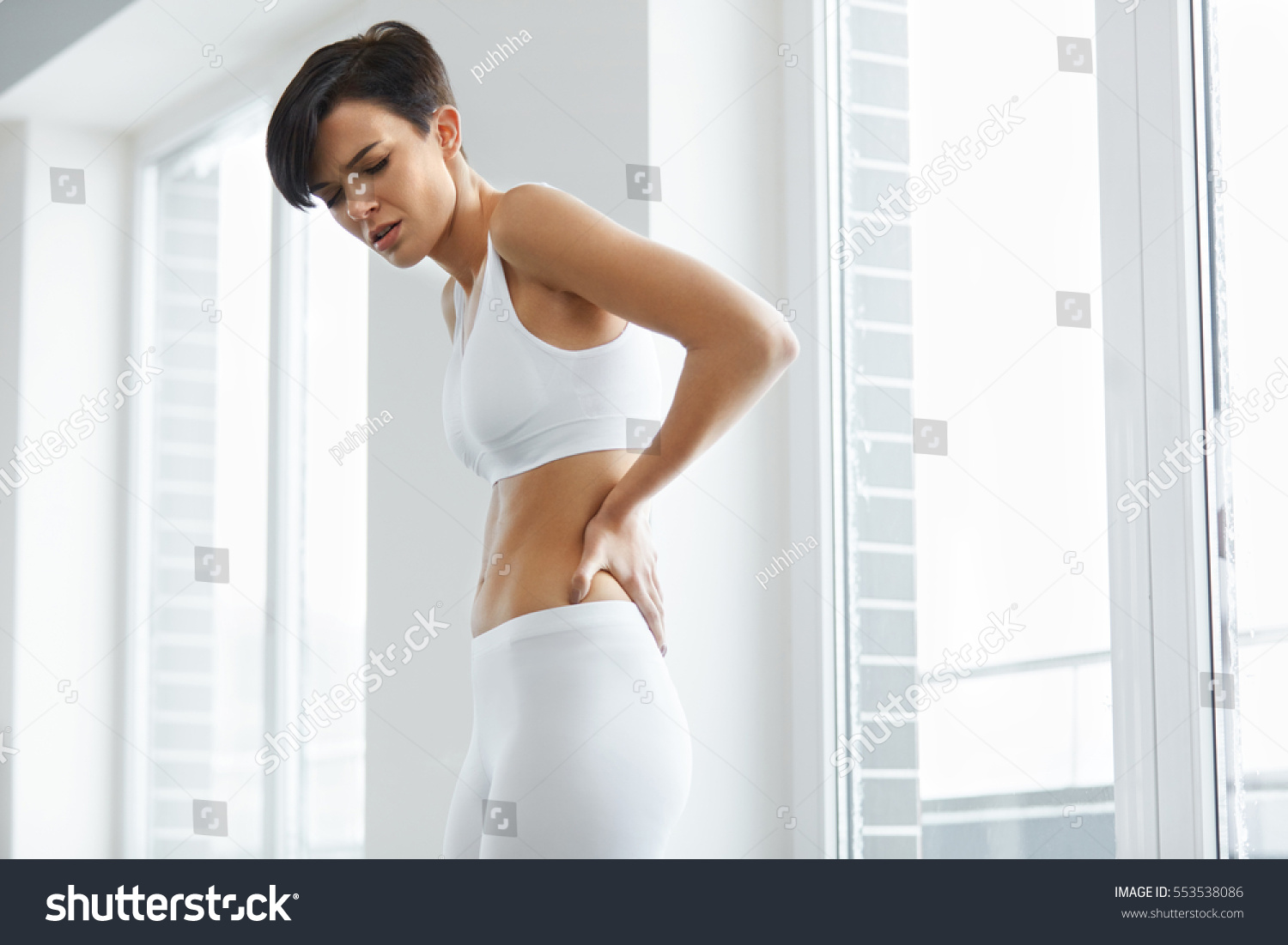 Back Pain. Beautiful Young Woman Feeling Strong Spinal Pain, Having ...