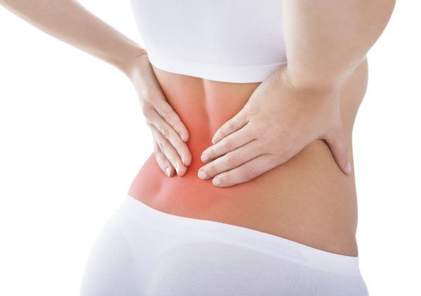 Woman Suffering From Back Pain - Lumo