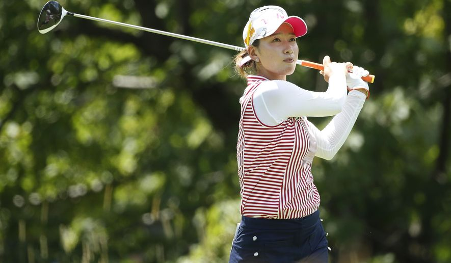 Chella Choi, of South Korea, watches her tee shot on the fifth hole ...