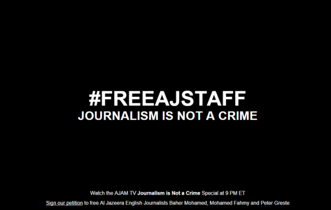 ... , Al Jazeera has blacked out its news site with a call to free them