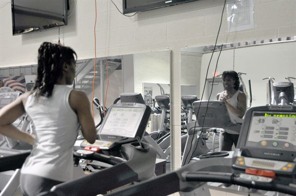 Tech. Sgt. Enid J Ellis runs on the treadmill in the Air Force Mortuary
